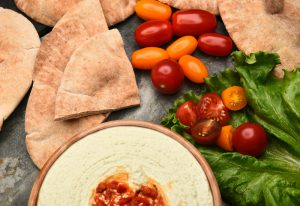 Pitta Bread with Hummus and Sliced Tomato