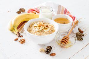 Porridge with Banana and Spoon of Honey