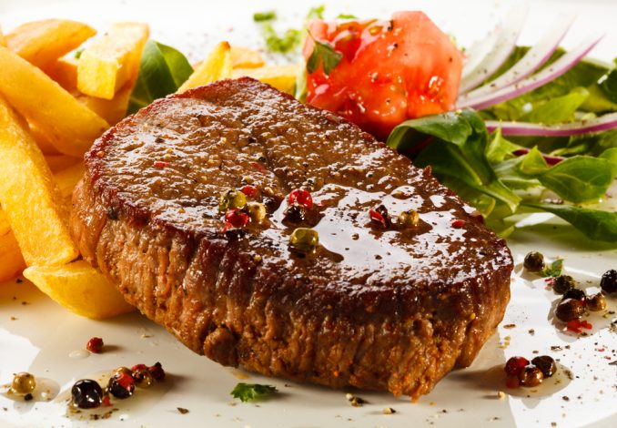 Steak with Chips and Leafy Green Salad