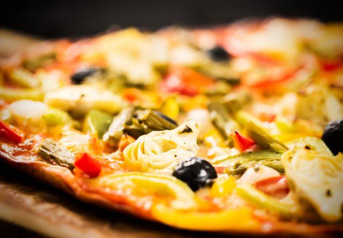 Vegan Pizza with Avocado Artichokes and Tomato